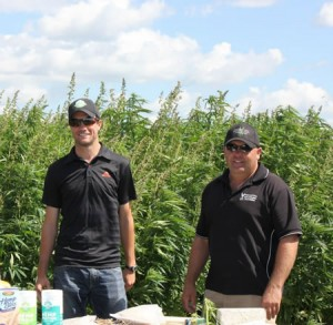 Manitoba Harvest's Will Wellborn and Parkland Crop Diversification Foundation's Jeff Kostuik talk hemp at PCDF's 2013 field Source